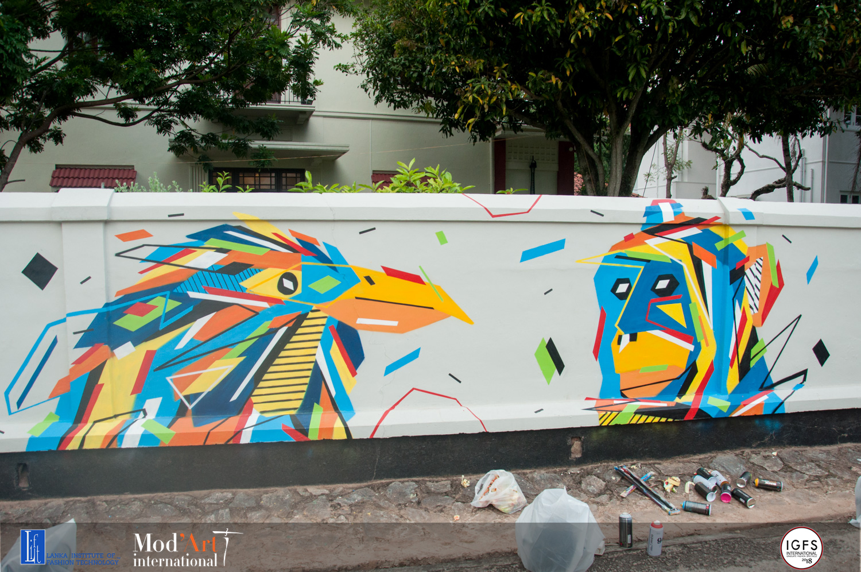Fresque Graffaune Graffiti oiseau et singe réalisée par Daco