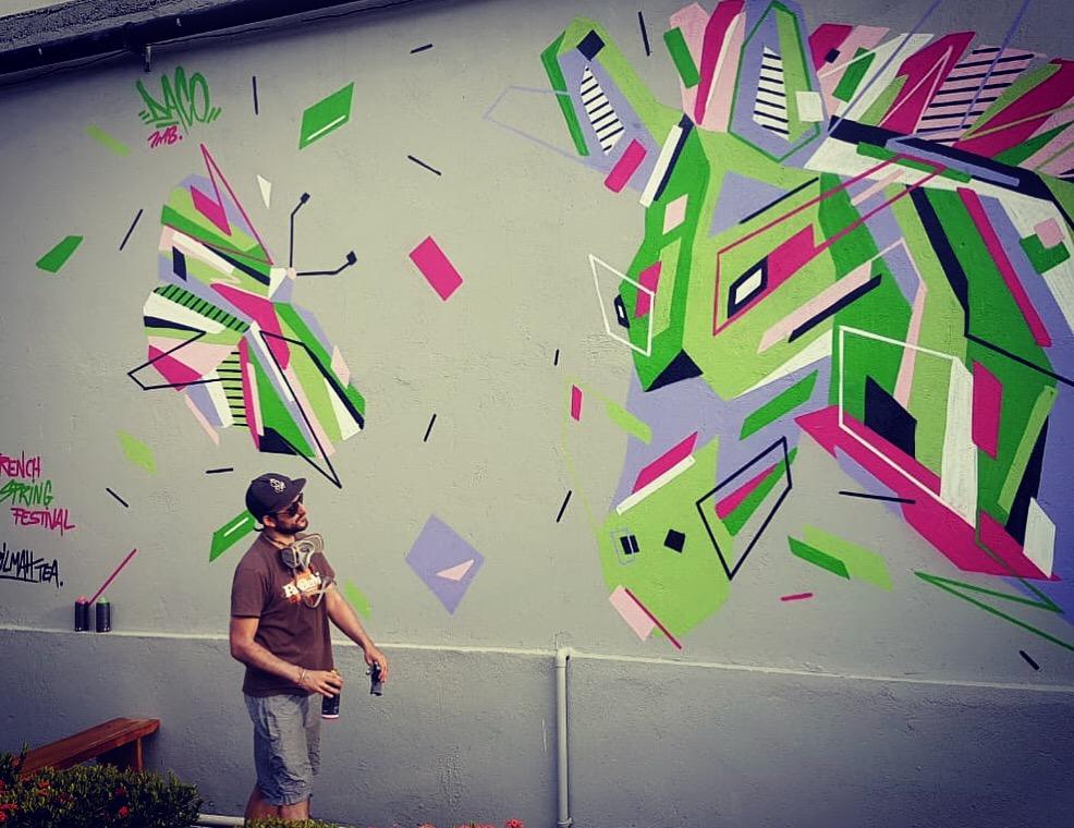 Fresque Graffaune Graffiti papillon et cheval réalisée par Daco